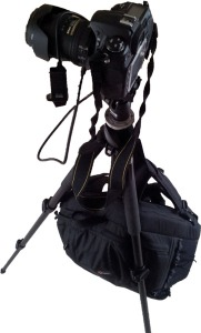 Camera bag suspended from tripod to demonstrate extra stability