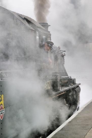 steam train enveloped in lots of steam