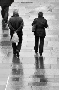 A couple walking in the rain