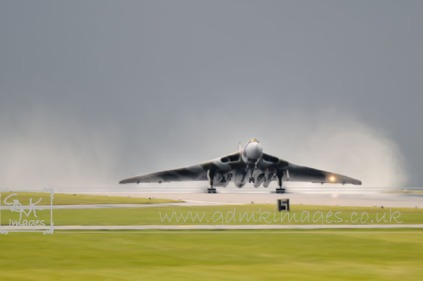 digital painting vulcan bomber taking off in rainstorm