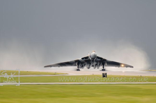 digital painting vulcan bomber taking off in rainstorm