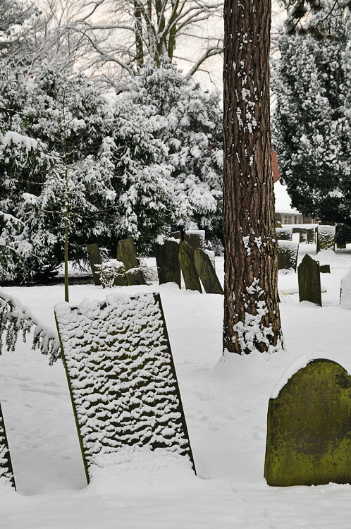 St Marys church yard with snow covered headstones