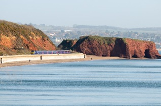 train on dawlish sea wall