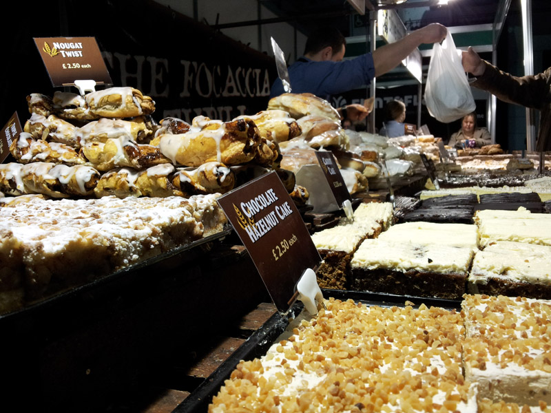 Selection of cakes being sold from a traders market style stall