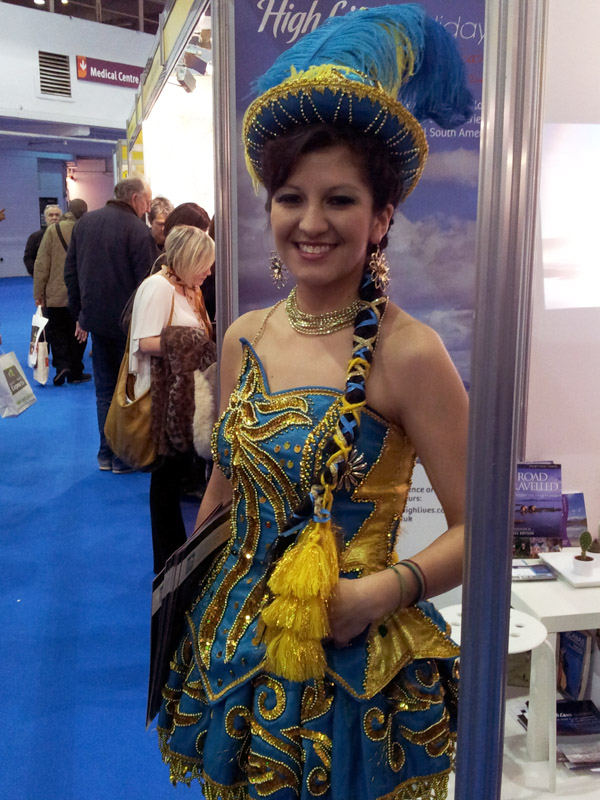 Traditionally dressed woman at a travel trade show