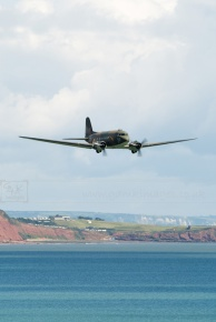 BBMF Dakota flying low over the coast aircraft aeroplane