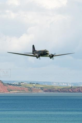 BBMF Dakota flying low over the coast aircraft aeroplane