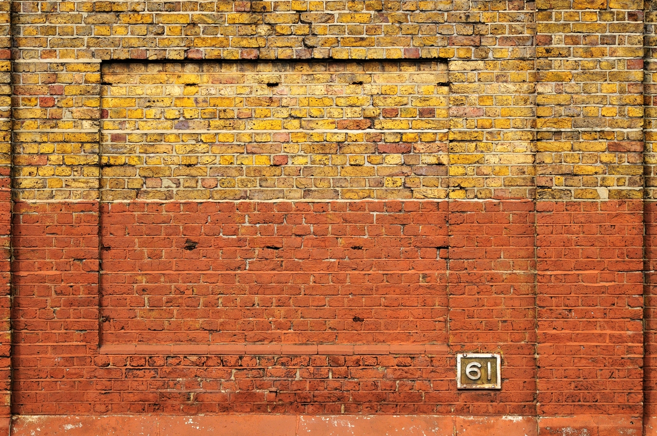 gold and red brick wall