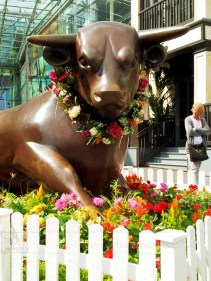 Birmingham Bull Ring bronze statue decorated flowers