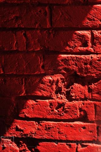 weekly photo project - red brick wall half shadow